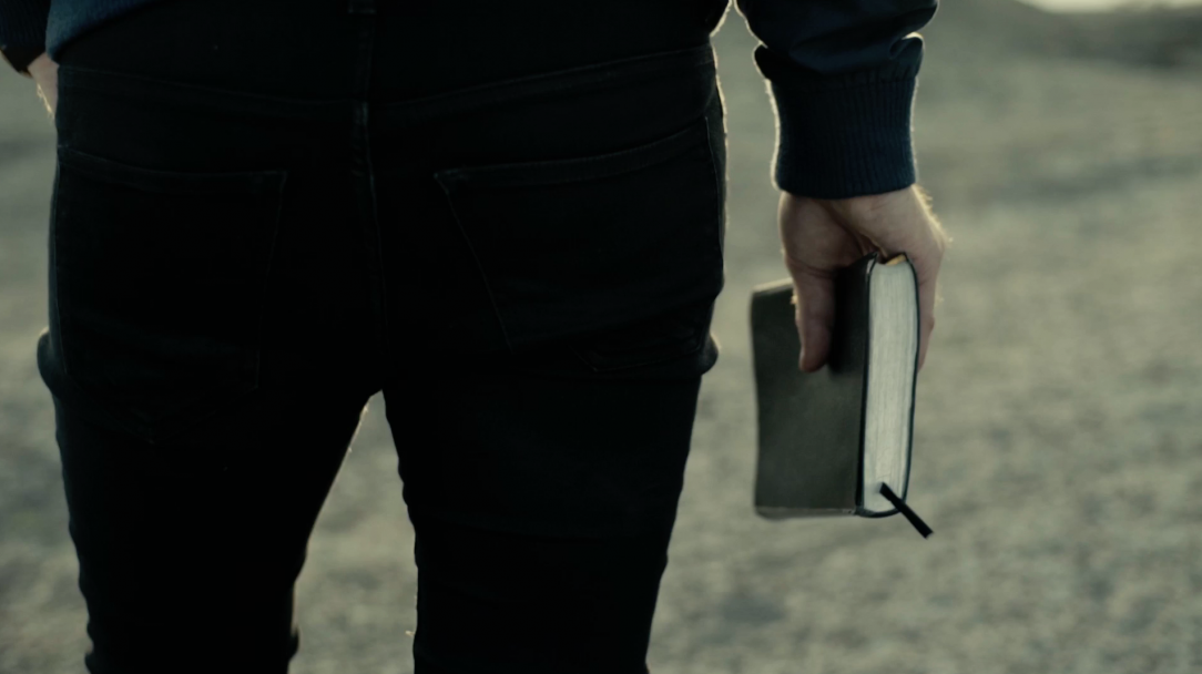 Man Walking With Bible